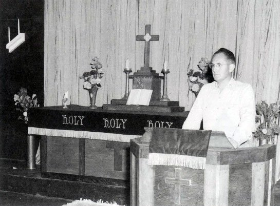 """Chaplain Charles F. """"Pat"""" Murphy during a Sunday morning service."""