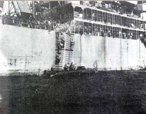 Sixth BG Men Disembark from Sea Marlin at Tinian Harbor